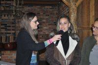 A empreendedora Cris sendo entrevistada pela apresentadora Érica Prêmoli.