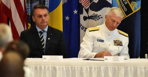 x87405098_Brazilian-President-Jair-BolsonaroC-sits-next-to-Commander-US-Southern-Command-Admiral-Crai.jpg.pagespeed.ic.yNm1cc-H_h
